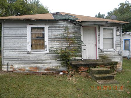 House with rot and collapsing roof