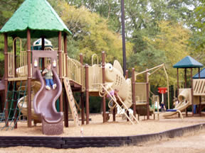 Playground with tall slide